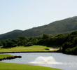 The par-3 eighth hole at Kahili Golf Course is a long shot over water.