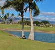 Palm trees, water and trade winds are what defend Hawaii Prince Golf Club.