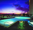 The pool of the Hawaii Prince Hotel Waikiki sits on a fifth floor roof, overlooking a marina.