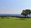 The 17th hole of the Kings' Course at Waikoloa Beach Resort features a barren lava field of black rock as a backdrop.
