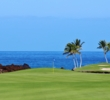 The ocean paints quite the picture of the 13th green on the South Course at Mauna Lani Resort.