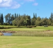 When the tradewinds are blowing, this pond in front of the seventh green is in play on both the drive and approach shot on the Palmer Course at Turtle Bay Resort.
