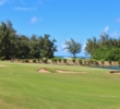 Although the pond is the water you have to worry about, the glimpse of the ocean is what you'll remember on the 18th hole of the Palmer Course at Turtle Bay Resort.