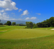 The fifth hole at Makai Golf Club is a dogleg left, parkland par 5.