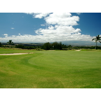 The 174-yard par-3 12th at Waikoloa Resort Beach Course features three greenside bunkers.