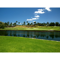 Water comes into play on the approach shot of the par-4 15th at the Waikoloa Resort Beach Course.