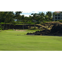 One of the most picturesque holes at the Waikoloa Resort Beach Course is the par-4 fifth, which plays around a large lava formation.