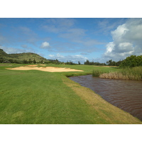 The 452-yard sixth hole on the Arnold Palmer Course at Turtle Bay Resort features water down most of the right side.