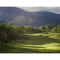 The Dunes at Maui Lani Golf Course's fourth hole is a par 5, playing to a green guarded by many pot bunkers.