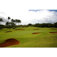 Kauai Lagoons Golf Club's 4th green is surrounded by bunkers and mounding.