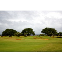 The par-5 14th hole on Kauai Lagoons plays towards the coast and into the trade winds.
