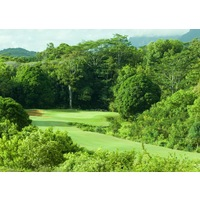 The par-4 13th hole on the Prince Course at Princeville resort is cut through dense jungle.