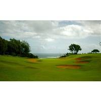 The par-4 sixth hole on the Prince Course at Princeville resort tumbles down towards the ocean into the trade winds.