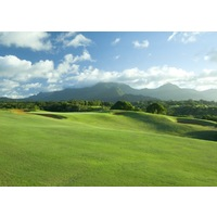 The par-4 17th hole at the Prince Course at Princeville resort plays on high ground back towards the clubhouse.