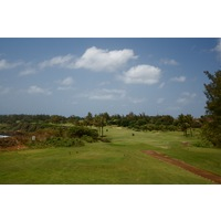 The par-4 16th hole wraps around the coastline at Poipu Bay Golf Course on Kauai's south shore.