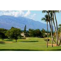 The par-4 fifth hole on Wailea Golf Club's Old Blue course plays downhill towards the west side of Maui.