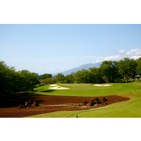 The 16th hole on the Gold Course at Wailea Golf Club is a par 3 that heads back toward the sea and West Maui Mountains.