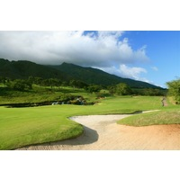 King Kamehameha Golf Club's par-5 11th hole features water and waterfalls in front of the green.
