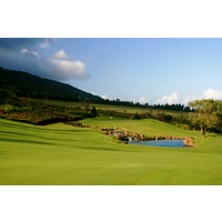 A waterfall runs into a pond on the 14th hole at King Kamehameha Golf Club on Maui.