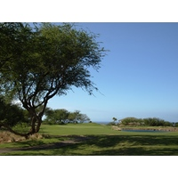 The ninth at Hapuna Golf Course is a 435-yard par 4 with a pond that catches errant approach shots to the right.