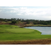 The short par-3 13th at Hapuna Golf Course is fronted by a lake.
