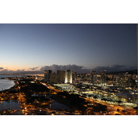 The balconies of the Hawaii Prince Hotel Waikiki serve up the night lights of Honolulu.