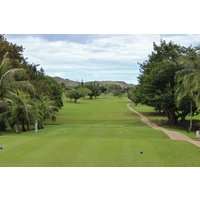The first tee introduces the tree-lined fairways of Olomana Golf Links in Waimanalo.