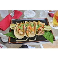 The Poipu Bay Grill & Bar overlooks the 18th green and serves huge salads and moist, delicious fish tacos.
