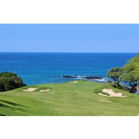 The 11th hole at Mauna Kea Golf Course drops to a green right on the ocean.