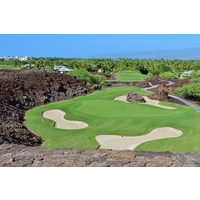 The 17th hole on the North Course at Mauna Lani Resort sits in a lava bowl.