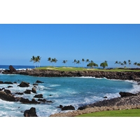 The 15th hole on the South Course at Mauna Lani Resort flies over a coastal cove.